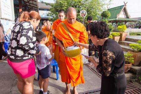 BANGKOK, Thailand - December 2, 2016: Children and parents offering of food to monks in the morning, in the school Pieamsuwan Bangkok, as the successor to a long tradition. Editorial