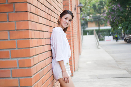 Portrait of thai adult working women white shirt relax and smile
