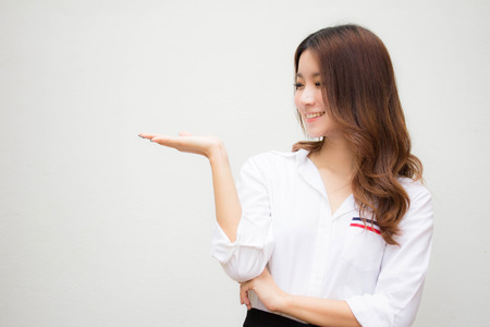 Portrait of thai adult working women white shirt  show hand Stock Photo