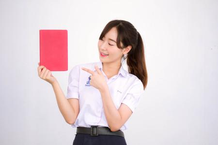 asia thai high school student uniform beautiful girl read a book Stock Photo
