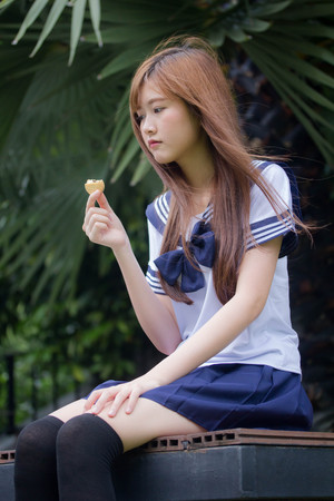 Portrait of thai teen beautiful girl in japanese student uniform happy and relax 스톡 콘텐츠