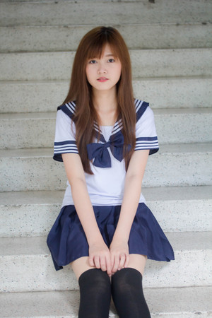 Portrait of thai teen beautiful girl in japanese student uniform happy and relax Zdjęcie Seryjne