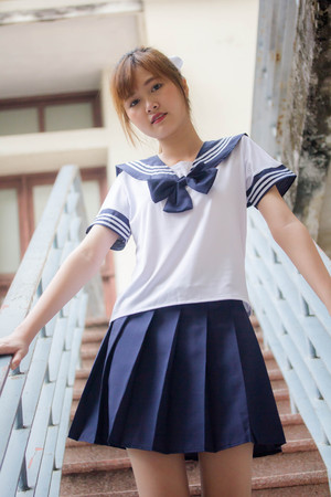 Portrait of thai teen beautiful girl in japanese student uniform happy and relax Imagens
