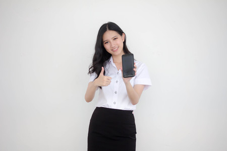 Portrait of thai adult student university uniform beautiful girl show her smart phone