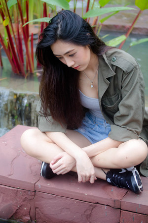 Portrait of thai adult beautiful girl relax and smile