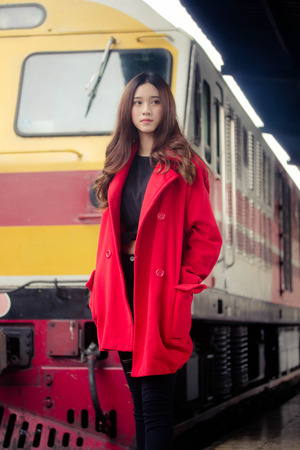 asia thai teen red coat in train station