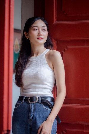 Portrait of thai china adult beautiful girl White shirt blue jeans relax and smile 写真素材