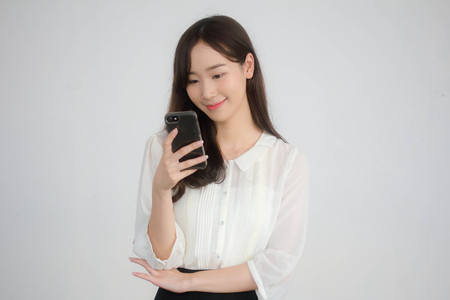 portrait of thai china adult office girl white shirt using her smart phone