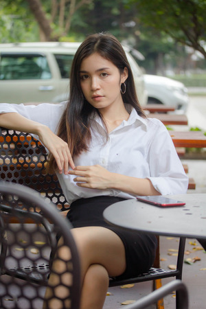thai china adult office girl white shirt relax and smile