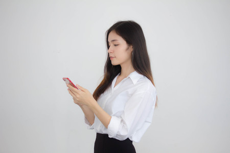 portrait of thai china adult office girl white shirt using her smart phone