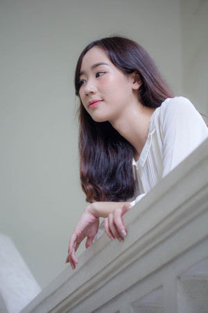 portrait of thai china adult office girl white shirt relax and smile Imagens