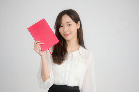 Portrait of thai adult working women white shirt show red book
