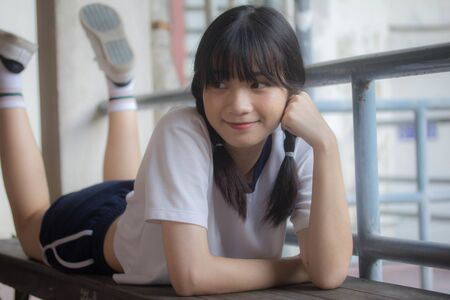 thai teen beautiful girl in japanese sports student uniform happy and relax