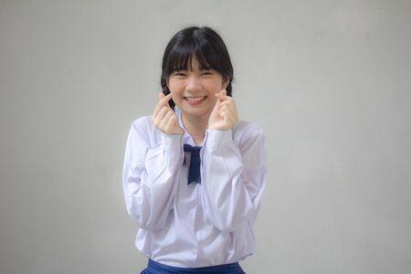 Portrait of thai high school student uniform beautiful girl give heart Banco de Imagens