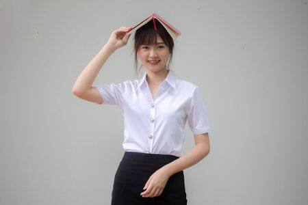 thai adult student university uniform beautiful girl and red book