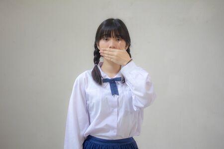 Portrait of thai high school student uniform beautiful girl not speak