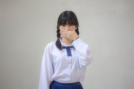 Portrait of thai high school student uniform beautiful girl not speak Reklamní fotografie - 133033621