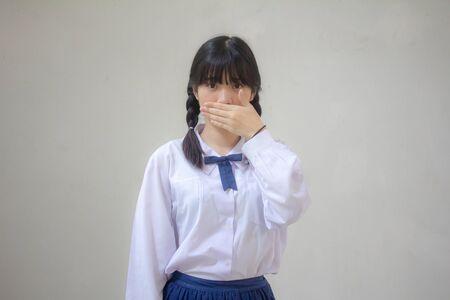 Portrait of thai high school student uniform beautiful girl not speak Reklamní fotografie - 132996334