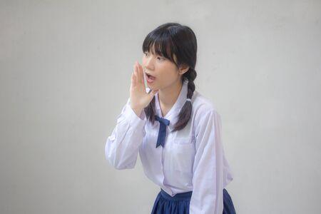Portrait of thai high school student uniform beautiful girl speak