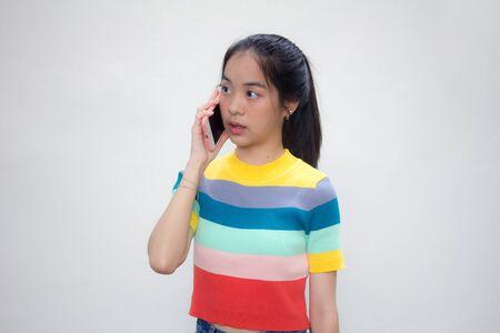 asia thai teen color t-shirt beautiful girl calling smart phone