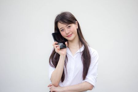 portrait of thai china adult office girl white shirt show her smart phone Фото со стока