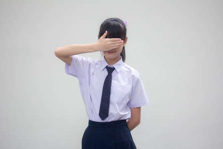 Portrait of thai Junior high school student uniform beautiful girl not look