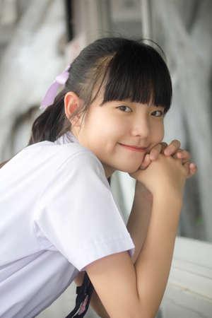 thai Junior high school student uniform teen beautiful girl happy and relax