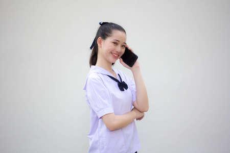 asia thai Junior high school student uniform beautiful girl calling smartphone