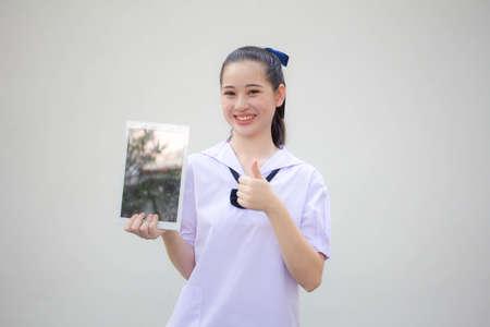 asia thai Junior high school student uniform beautiful girl show her tablet Zdjęcie Seryjne