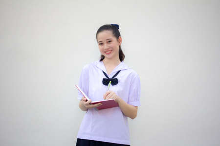 asia thai Junior high school student uniform beautiful girl Write a book