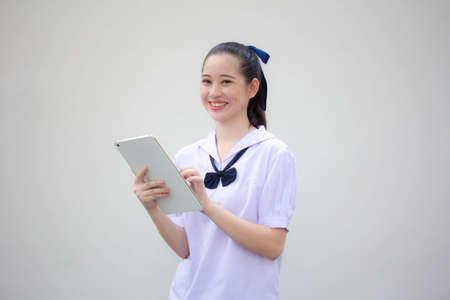 asia thai Junior high school student uniform beautiful girl using her tablet