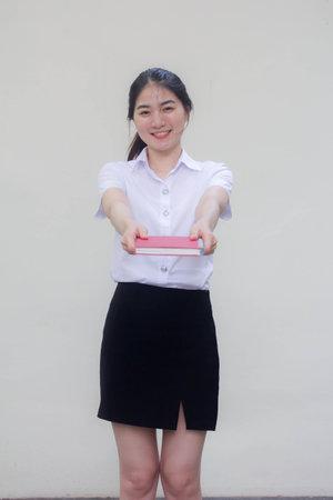 thai adult student university uniform beautiful girl show a book