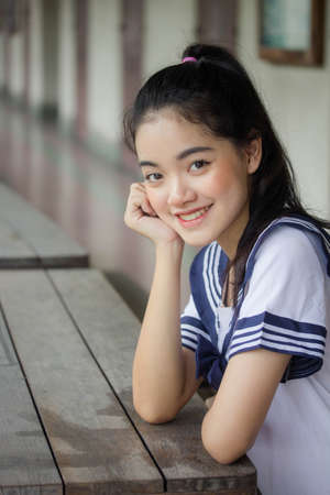 japanese teen beautiful girl in student uniform happy and relax