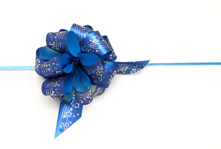 Blue ribbon on white background photo