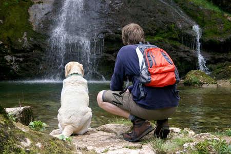 mountain dog: Man and his dog enjoying the beautiful view