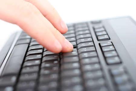 shallow dof: Hand on keyboard, shallow DOF Stock Photo