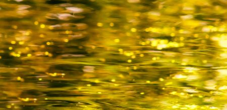 liquid gold: Gold water texture. Abstraction liquid metal. Element of design.