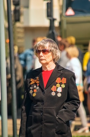 annexation: ULYANOVSK, RUSSIA - MAY 9, 2016: elderly woman with medals at the parade dedicated to the Victory Day. May, 9, 2016 in Ulyanovsk city, Russia.