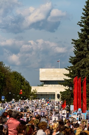 annexation: ULYANOVSK, RUSSIA - MAY 9, 2016: Procession of people with flags and photos their relatives in Immortal Regiment on annual Victory Day, May, 9, 2016 in Ulyanovsk city, Russia. Editorial