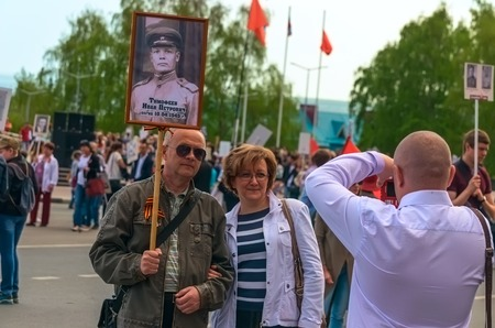 annexation: ULYANOVSK, RUSSIA - MAY 9, 2016: ULYANOVSK, RUSSIA - MAY 9, 2016: People after the march Immortal regiment. May, 9, 2016 in Ulyanovsk city, Russia. Editorial