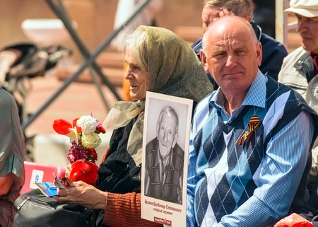 annexation: ULYANOVSK, RUSSIA - MAY 9, 2016: ULYANOVSK, RUSSIA - MAY 9, 2016: People are waiting for the procession of the Immortal regiment May, 9, 2016 in Ulyanovsk city, Russia.