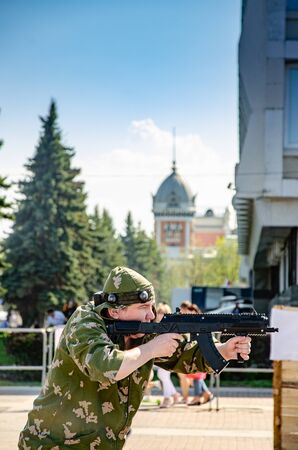 Ulyanovsk, Russia - May 09 2019: Celebrating the anniversary of victory in World War II. The game of laser tag on the central square of the city Sajtókép