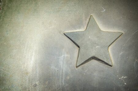 Details of a vintage car close-up. Details of military equipment. Metal star adorning the hood of a vintage armored vehicle. for advertising.
