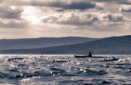 Kayaks on the Turgoyak lake, Ural, Russia.