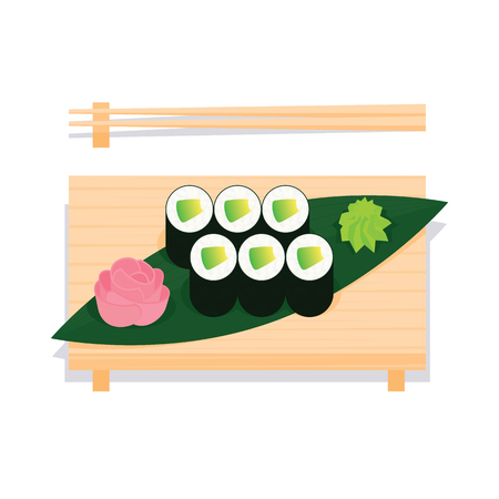 Maki sushi with avocado served on wooden board.