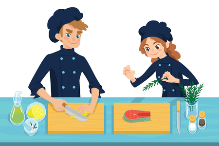 Happy young cooks. Boy slicing lemon and girl preparing salmon steak on chopping board.