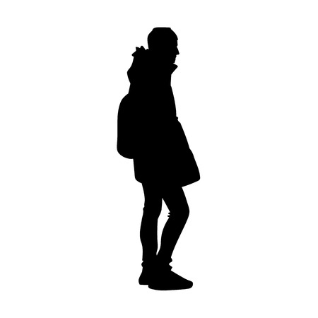 Young man in warm jacket, jeans and sneakers standing. Black silhouette isolated on white background. Side view. Monochrome vector illustration of young man with backpack. Concept Ilustração