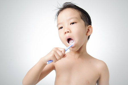 Both hold tooth brush for brushing his teeth. photo