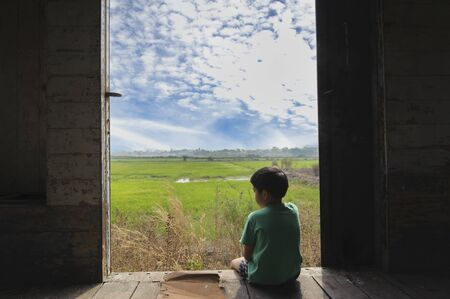 Asian Boy Sit Beside Window After Rain At Home Look Sad And Lonely