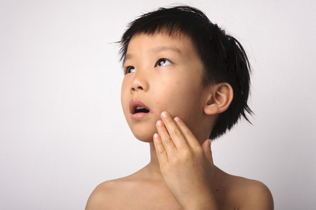 labialis: the herpes on young boy mouth feel pain Stock Photo
